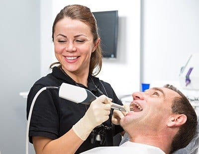 Man receiving intraoral images