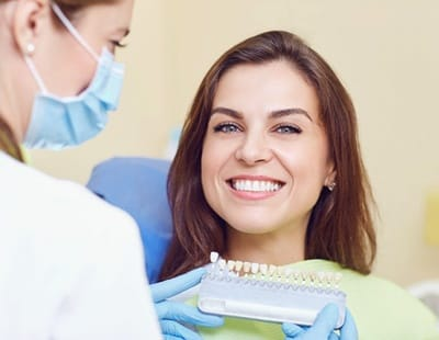 Woman smiling at dentist office