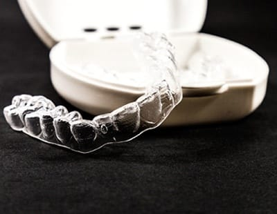 Clear aligner trays on a black background