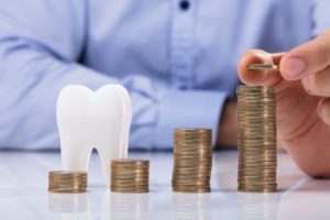 Dentist demonstrating are dental implants in Frederick worth the cost